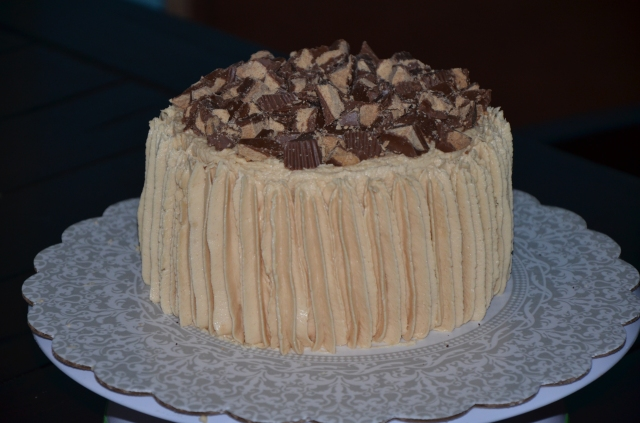 Gluten Free Peanut Butter Cup Cake: serves 12 (double chocolate cake with chocolate chunks filled and frosted with peanut butter buttercream topped with peanut butter cups. gluten-free)