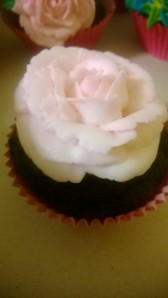 Pink and white buttercream rose.