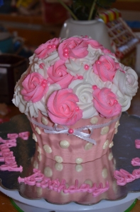 """Gluten Free, Double Fudge, Giant Cupcake Cake. Covered in Buttercream roses and a White Chocolate """"Wrapper"""" Serves 6-8. Great for a First Birthday Party! 40.00"""