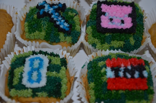 Minecraft Cupcakes Gluten Free. Available in a variety of flavors and fillings. Buttercream, hand piped, cupcake toppers.