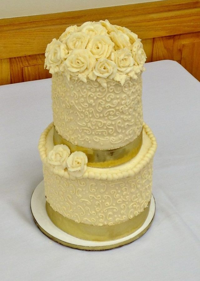 Order this cake in its smallest version (as seen here) for $150.00 (serves 50-60) or order a larger version of this cake, with additional tiers and a decorated cake board to fit you budget and celebration size.
