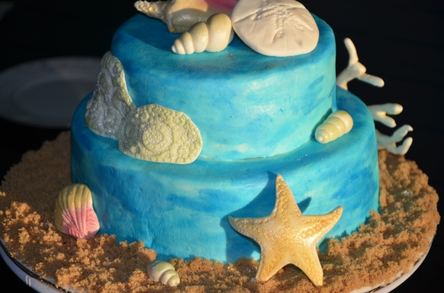 Under the Sea: By Grace Cakes bakery original, gluten free cake. Butter vanilla sponge covered in handpainted marshmallow fondant.